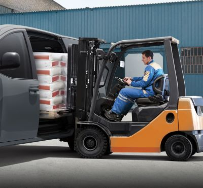The Hyundai STARIA Van being loaded with a forklift.