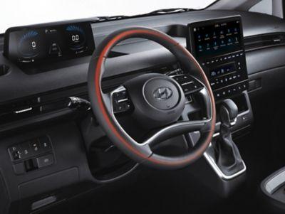 The heated steering wheel inside of the all-new Hyundai STARIA multi-purpose vehicle.