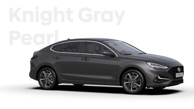 The Hyundai i30 Fastback in the colour Knight Gray Pearl.
