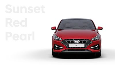 The Hyundai i30 Fastback in the colour Sunset Red Pearl.