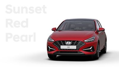 The Hyundai i30 in the colour Sunset Red Pearl.