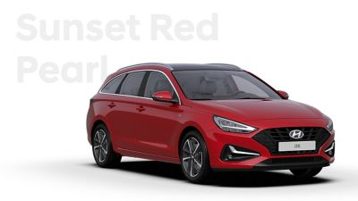 The Hyundai i30 Wagon in the colourSunset Red Pearl.