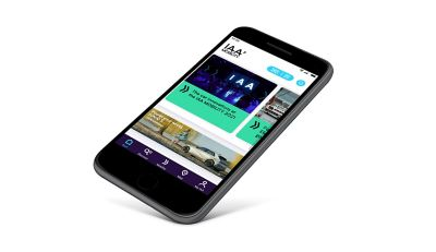 smartphone with the IAA Mobility App open on the screen