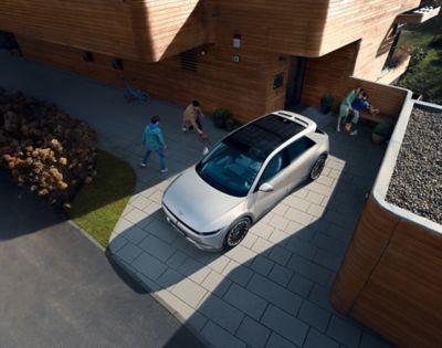 Hyundai IONIQ 5 electric midsize CUV parked in a driveway, seen from above.