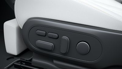 Details of the controls for the fully reclining front seats of the Hyundai IONIQ 5 electric midsize CUV.