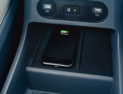 The Hyundai IONIQ 5 electric CUV's high-speed wireless charger ports in the front and back seats.
