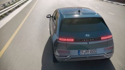Interior view of the Hyundai IONIQ 5 Project 45 all-electric compact SUV parked next to a building.