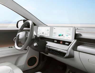 The wide-screen digital cockpit inside the Hyundai IONIQ 5 midsize CUV.