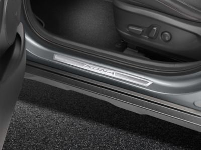 Genuine Accessories stainless steel entry guards of the Hyundai Kona Electric.