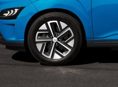 "The new Hyundai Kona Electric compact SUV from the side with its new 17"" alloy wheels."