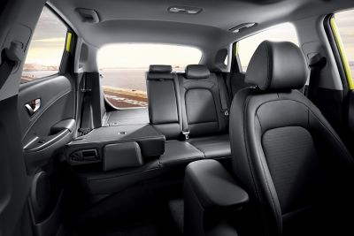 A photo of the all-new Hyundai Kona's spacious interior, with seats folded down.