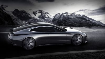 Rendering of the back of the 2018 Le Fil Rouge concept car driving in front of a mountain range.