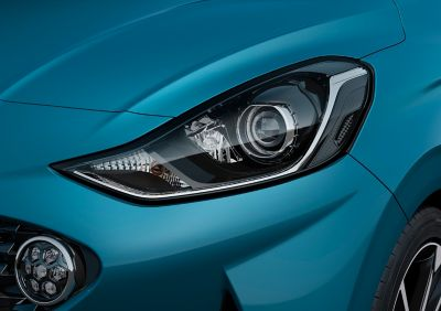 A close up look at the Hyundai i10's Bi-function projection headlamps and LED Daytime Running Lights.