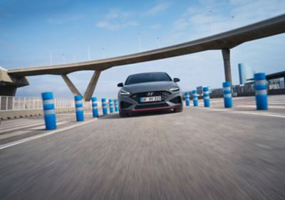 Hyundai i30 Fastback N from the front, driving on a racetrack