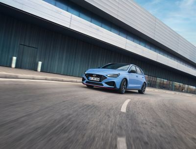 the new Hyundai i30 N performance hatchback in Performance Blue, slicing through a curve.