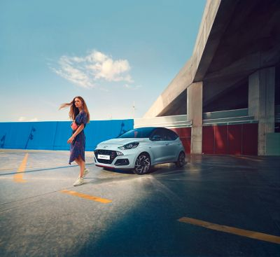 Woman in front of the all-new Hyundai i10 N Line