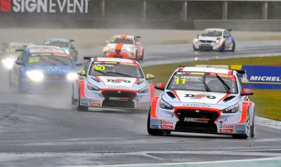 A picture of Hyundai Motorsport's i30 N TCR in action on a racetrack shown from the front