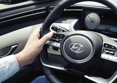 Close up image of the button on the steering wheel of the all-new Hyundai Tucson SUV.