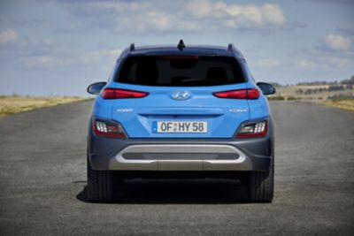 View of the new Hyundai KONA from the rear, highlighting the rear bumper and skid plate.