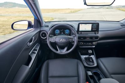 Steering wheel and digital cluster of the Hyundai KONA from the driver's point of view