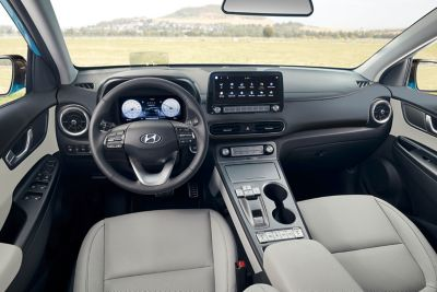 The interior of the new Hyundai Kona Electric SUV with drive-by-wire shifter buttons.