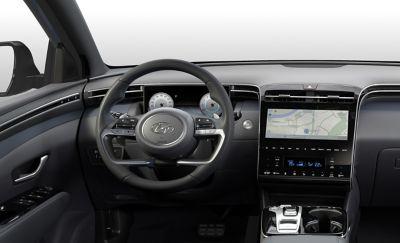 Vista interna del SUV compatto Nuova Hyundai TUCSON Hybrid con il volante.