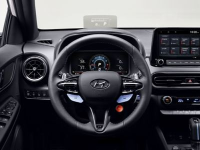 Leather steering wheel with the N Grin Shift button inside the Hyundai KONA N hot SUV.