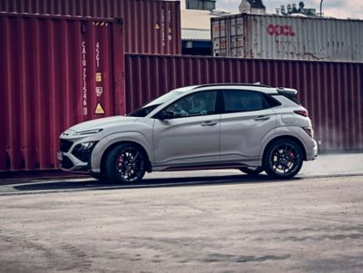 Hyundai KONA N seen from the side in an industrial setting