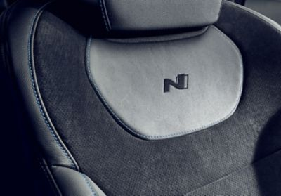 Detail of Performance Blue contrast stitching on the seat of the Hyundai KONA N hot SUV.
