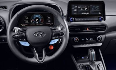Leather steering wheel with the N Grin Shift button inside the Hyundai KONA N hot SUV