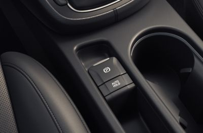 The electric parking brake in the centre console of the new Hyundai Kona.