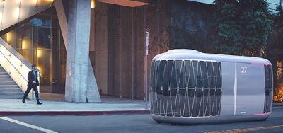 A Hyundai future mobility Purpose Built Vehicle on a city street.