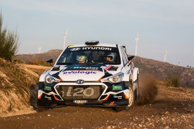 Photo of the Hyundai i20 Coupe WRC on a dirt road.