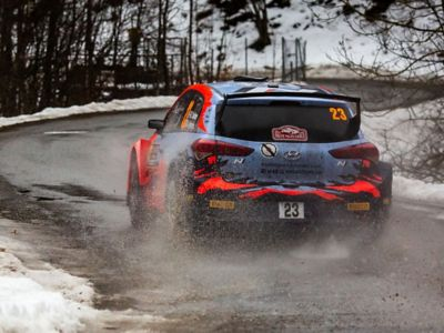 Hyundai Motorsport customer racing rally car i20 R5 in action from the rear.