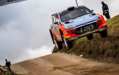 Hyundai Motorsport customer racing rally car i20 R5 in action driving a dusty road in the mountains.