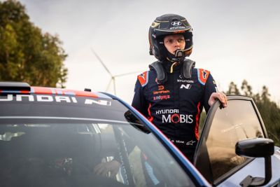 Hyundai Motorsport driver Ott Tänak wearing his helmet preparing to enter the car