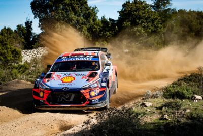 The Hyundai i20 Coupe WRC on gravel road in the Rally Sardinia.