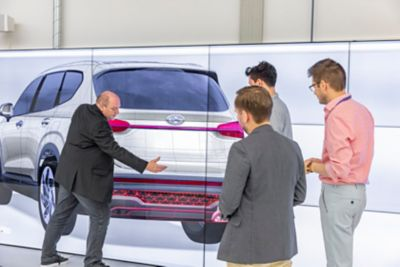 Four designers discussing the rear design of the new Hyundai Santa Fe 7 seat SUV.