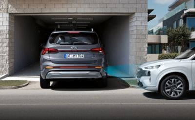 The new Hyundai Santa Fe Hybrid 7 seat SUV using the Reverse Parking Collision-Avoidance Assist.