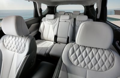 Interior view of the new Hyundai Santa Fe Hybrid 7 seat SUV showing all the seats.