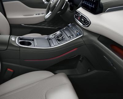 An interior view of the new Hyundai Santa Fe 7 seat SUV showing the tray under the centre console.