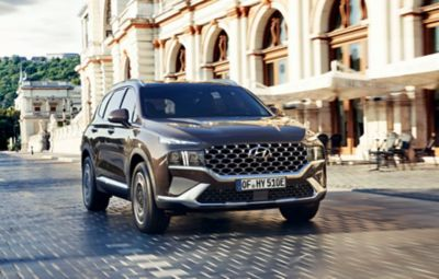 The new Hyundai Santa Fe Plug-in Hybrid 7 seat SUV showing its new full LED headlamps and bumper.