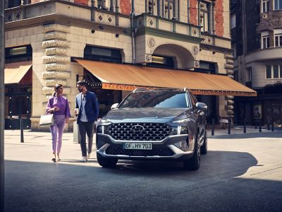 The new Hyundai Santa Fe 7 seat SUV pictured from the front parked in the city.