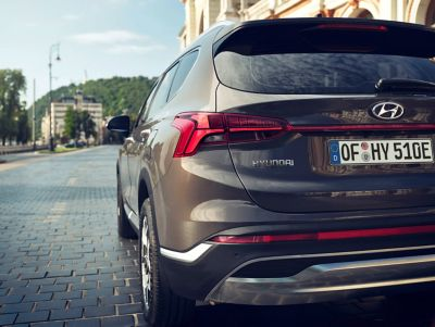 The new Hyundai Santa Fe Plug-in Hybrid7 seat SUV showing its new taillight design.