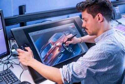 A Hyundai designer drawing the exterior design of the new Hyundai Santa Fe 7 seat SUV.