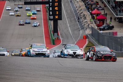 Several vehicles competing during a TCR race.