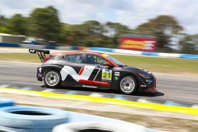 The Hyundai i30 N TCR on a race track.