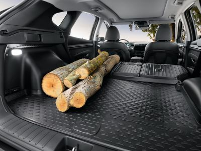 The Hyundai TUCSON interior covered with the waterproof, antislip trunk liner.