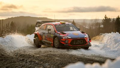 The Hyundai i20 Coupe WRC taking a tight turn.
