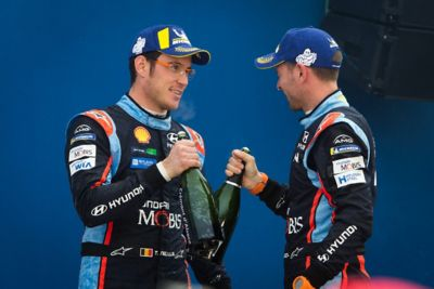 Rally driver Thierry Neuville and co-driver Nicolas Gilsoul at an awards ceremony.
